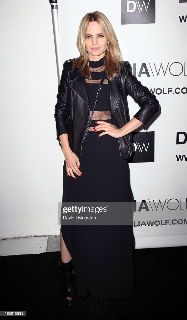 Actress <a gi-track='captionPersonalityLinkClicked' href=/galleries/search?phrase=Mena+Suvari&family=editorial&specificpeople=156413 ng-click='$event.stopPropagation()'>Mena Suvari</a> attends the Dahlia Wolf Launch Party at the Graffiti Cafe on October 22, 2013 in Los Angeles, California.