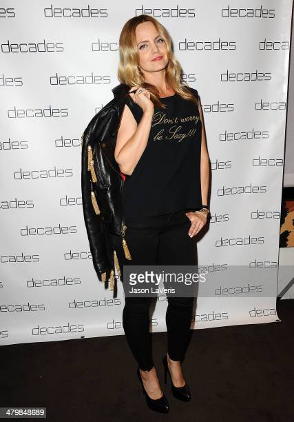 Actress Mena Suvari attends the Decades Les Must De Moschino event at Decades on March 20 2014 in Los Angeles California
