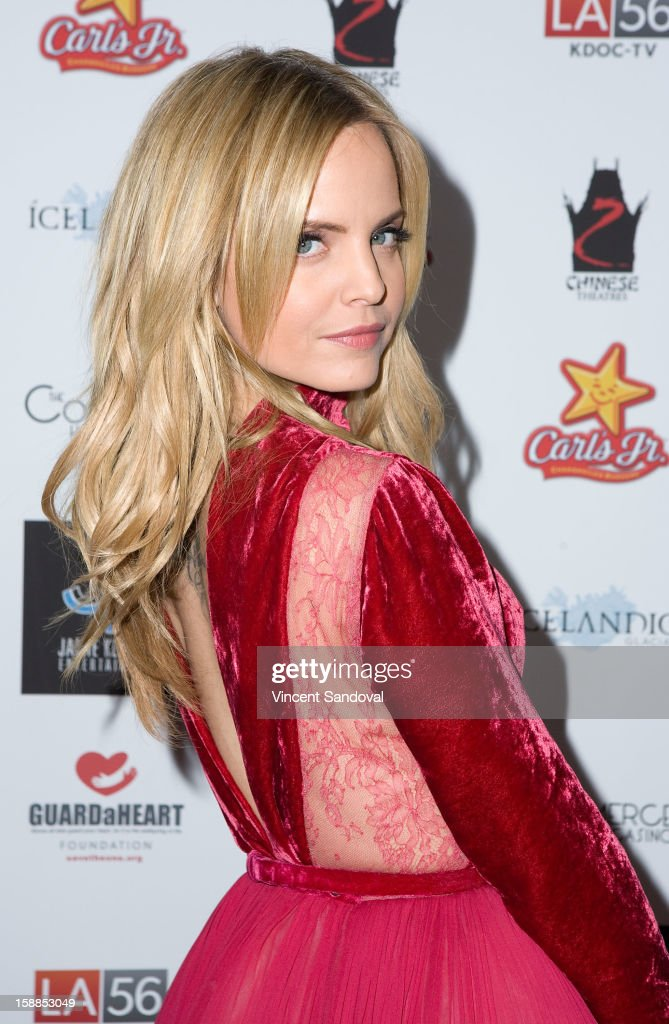 Actress <a gi-track='captionPersonalityLinkClicked' href=/galleries/search?phrase=Mena+Suvari&family=editorial&specificpeople=156413 ng-click='$event.stopPropagation()'>Mena Suvari</a> attends the 'First Night 2013' New Year's Eve Party hosted by Jamie Kennnedy at Grauman's Chinese Theatre on December 31, 2012 in Hollywood, California.