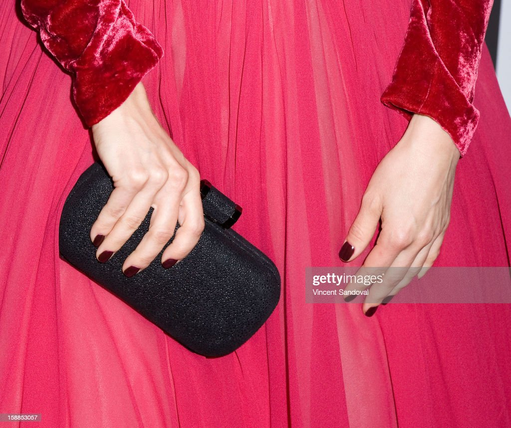 Actress Mena Suvari (purse detail)attends the 'First Night 2013' New Year's Eve Party hosted by Jamie Kennnedy at Grauman's Chinese Theatre on December 31, 2012 in Hollywood, California.