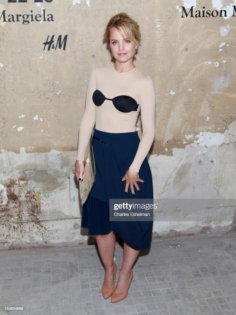 Actress Mena Suvari attends the Maison Martin Margiela & H&M Global launch party at 5 Beekman on October 23, 2012 in New York City.