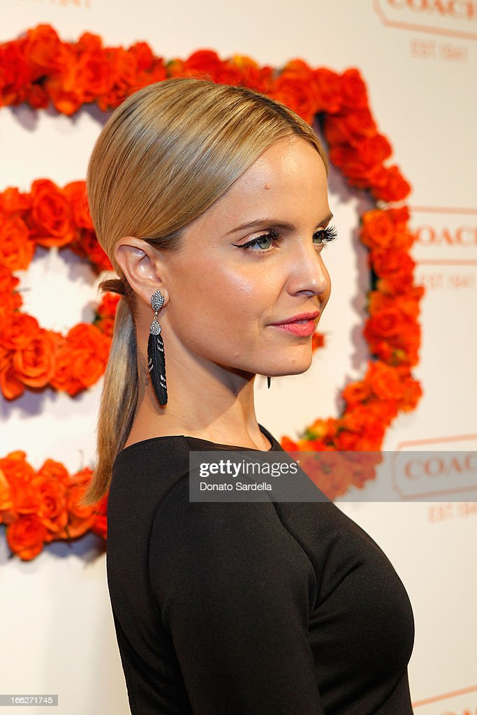 Actress Mena Suvari carrying Coach attends Coach's 3rd Annual Evening of Cocktails and Shopping to Benefit the Children's Defense Fund hosted by Katie McGrath, J.J. Abrams and Bryan Burk at Bad Robot on April 10, 2013 in Santa Monica, California.