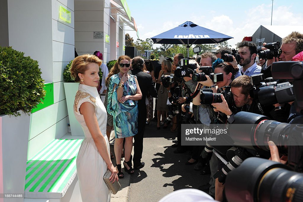Actress Mena Suvari poses for a photo in the birdcage on Crown Oaks Day at Flemington Racecourse on November 8, 2012 in Melbourne, Australia.