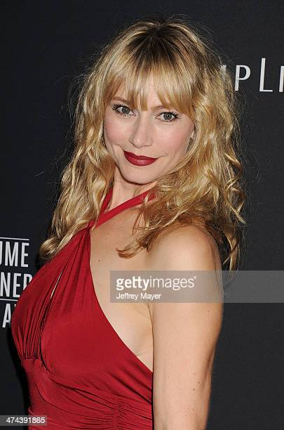 Actress Meredith Monroe arrives at the 16th Costume Designers Guild Awards at The Beverly Hilton Hotel on February 22 2014 in Beverly Hills California
