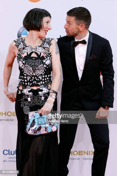 Actress Meret Becker and a guest attend the Lola German Film Award red carpet at Messe Berlin on April 28 2017 in Berlin Germany