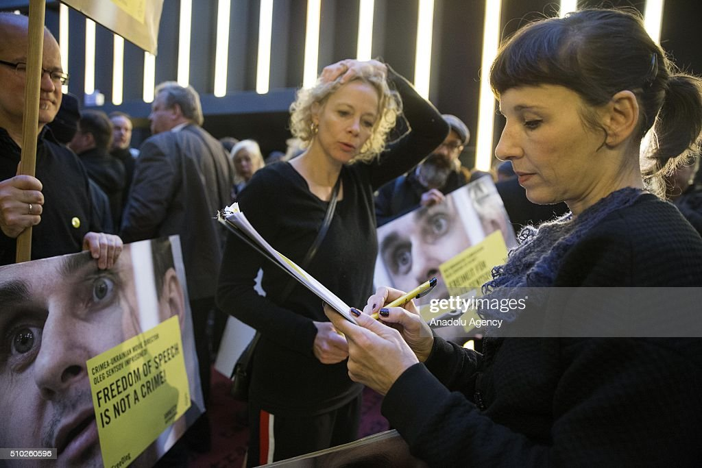 Actress Meret Becker (R) takes part in a protest for the release of Ukrainian director Oleg Sentsov during the 66th annual Berlin International Film Festival, in Berlin, Germany, 14 February 2016.