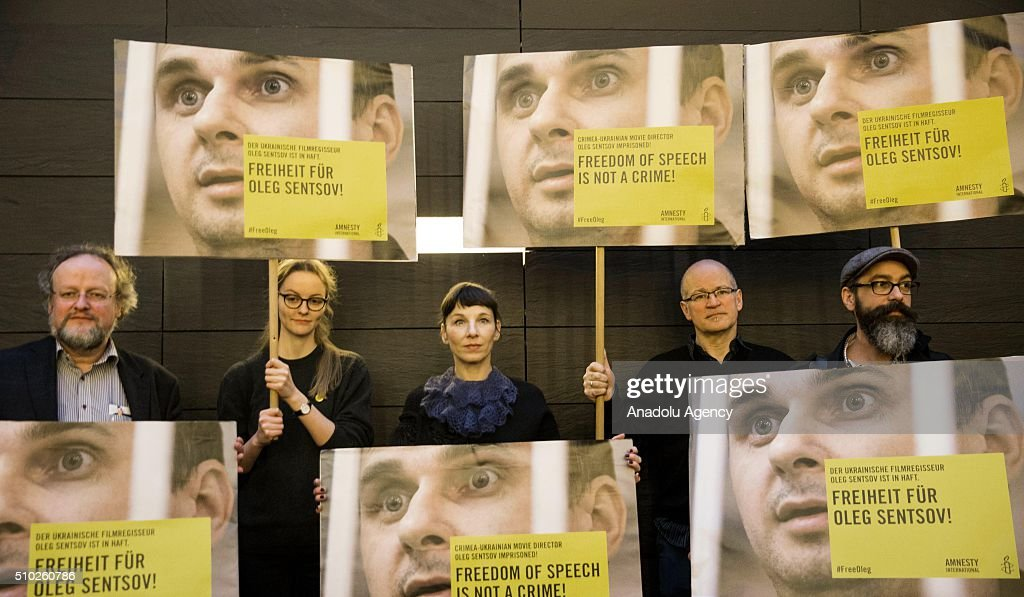 Actress Meret Becker (C) takes part in a protest for the release of Ukrainian director Oleg Sentsov during the 66th annual Berlin International Film Festival, in Berlin, Germany, 14 February 2016.