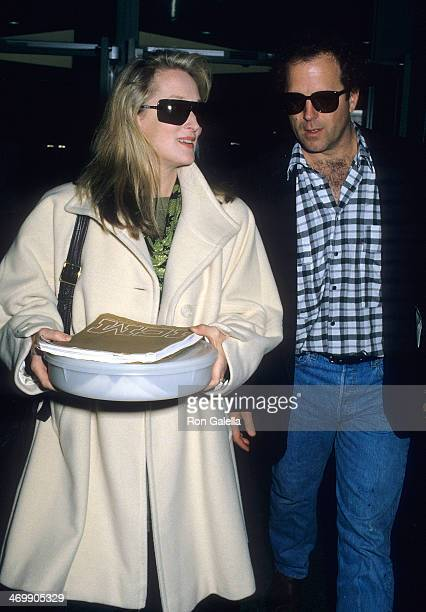 Actress Meryl Streep and husband Donald Gummer depart for New York City on April 12 1988 from the Los Angeles International Airport in Los Angeles...