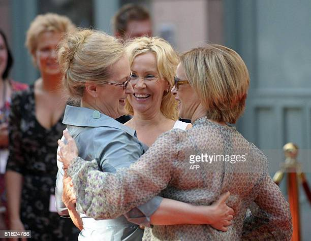 US actress Meryl Streep gets a hug from original Abba members Agnetha Faltskog and Annifrid Reuss at the Swedish premiere of the movie Mamma Mia in...