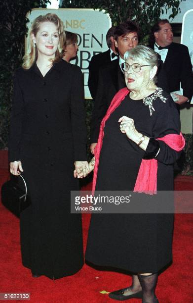 Actress Meryl Streep holds hands with her mother upon their arrival at the 56th Annual Golden Globe Awards in Beverly Hills 24 January Streep is...