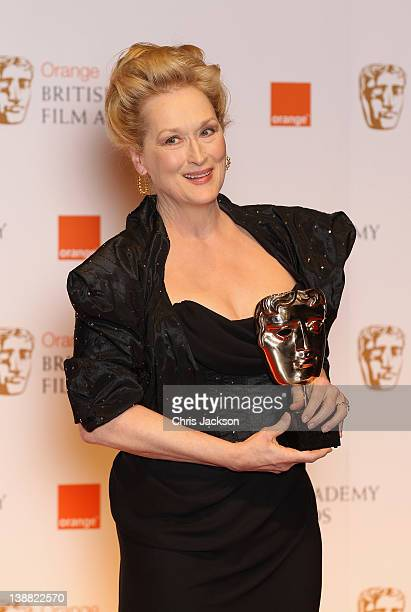Actress Meryl Streep poses in the press room with the Best Actress award for 'The Iron Lady'during the Orange British Academy Film Awards 2012 at the...