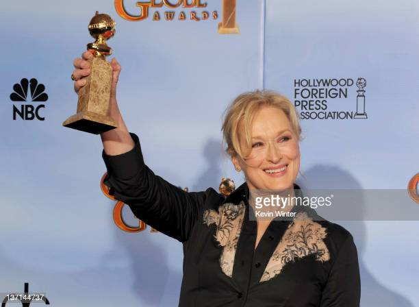 Actress Meryl Streep poses in the press room with the Best Performance by an Actress in a Motion Picture Drama award for 'The Iron Lady' at the 69th...