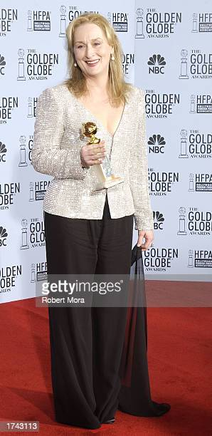 Actress Meryl Streep poses with her Best Performance By An Actress In A Supporting Role In A Motion Picture award for 'Adaptation' backstage during...