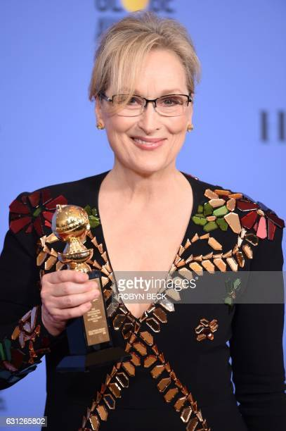 Actress Meryl Streep poses with The Cecil B DeMille Award in the press room during the 74th Annual Golden Globe Awards at The Beverly Hilton Hotel on...