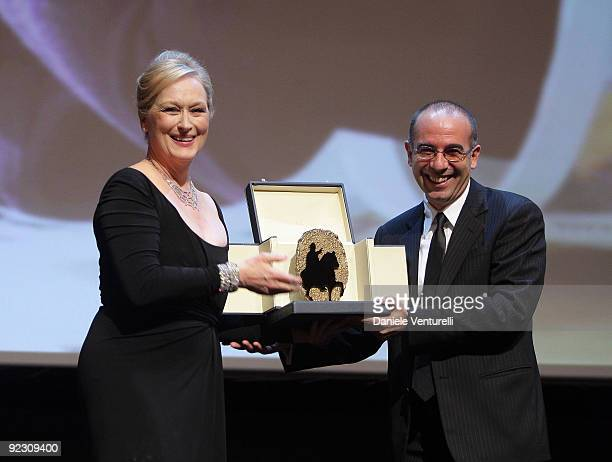 Actress Meryl Streep smiles as she receives The Golden Marc'Aurelio Acting Award from director Giuseppe Tornatore during the Official Awards Ceremony...