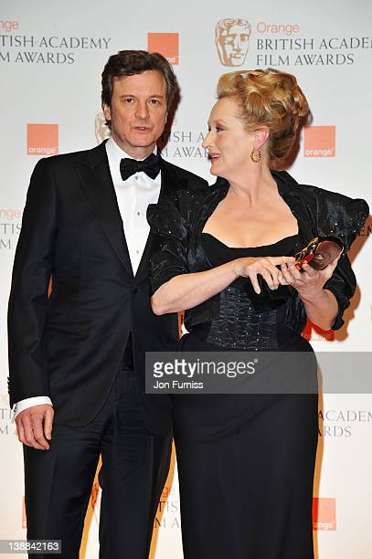 Actress Meryl Streep winnner of Best Actress for 'Iron Lady' with actor Colin Firth during the Orange British Academy Film Awards 2012 at the Royal...