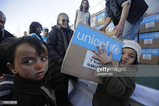 US Actress Mia Farrow a UNICEF goodwill ambassador distributes clothes to Syrian refugees in Baalbek in the Lebanese Bekaa valley on January 15 2013...
