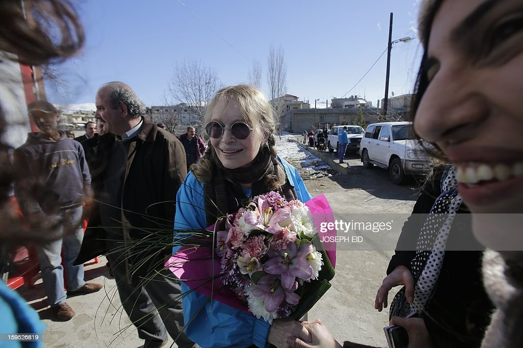 US Actress Mia Farrow (C), a UNICEF goodwill ambassador, visits Syrian refugees in Baalbek, in the Lebanese Bekaa valley on January 15, 2013. Farrow is on a two day visit to Lebanon, meeting Syrian refugees.