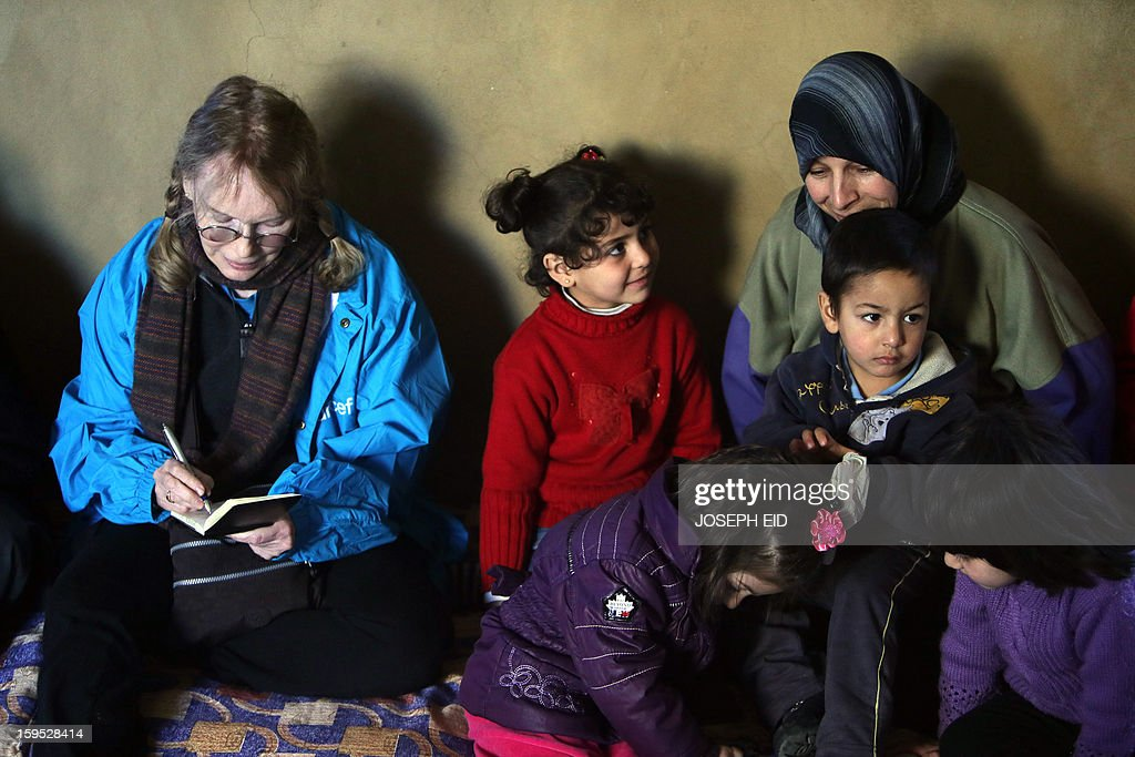 US Actress Mia Farrow (L), a UNICEF goodwill ambassador, visits Syrian refugees in Baalbek, in the Lebanese Bekaa valley on January 15, 2013. Farrow is on a two day visit to Lebanon, meeting Syrian refugees.