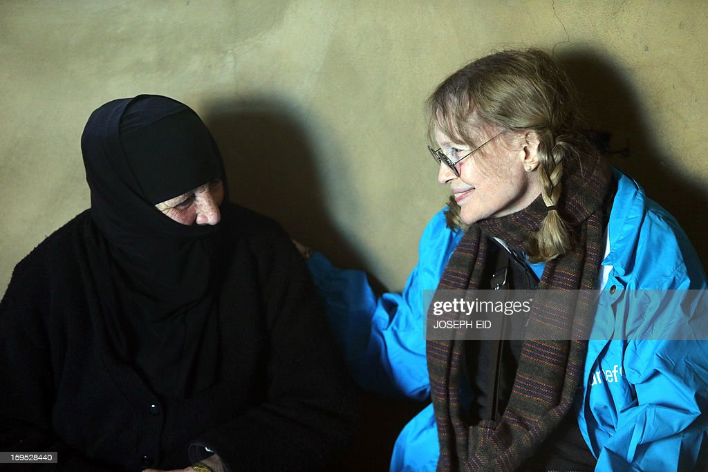 US Actress Mia Farrow (R), a UNICEF goodwill ambassador, visits Syrian refugees in Baalbek, in the Lebanese Bekaa valley on January 15, 2013. Farrow is on a two day visit to Lebanon, meeting Syrian refugees.