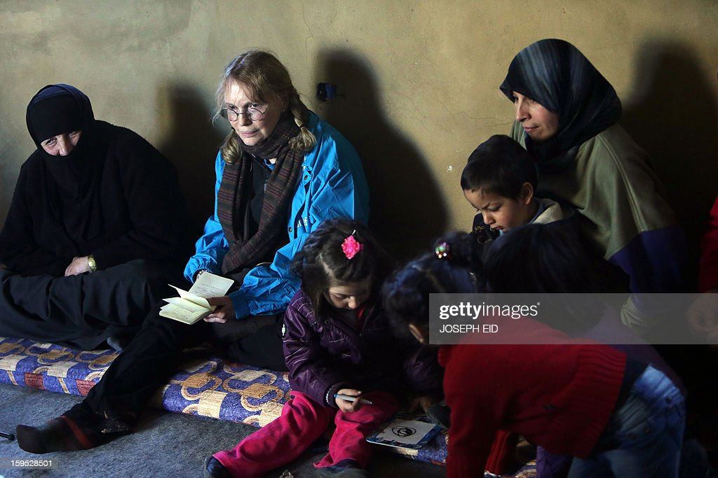 US Actress Mia Farrow (L), a UNICEF goodwill ambassador, visits Syrian refugees in Baalbek, in the Lebanese Bekaa valley on January 15, 2013. Farrow is on a two day visit to Lebanon, meeting Syrian refugees. AFP PHOTO/JOSEPH EID