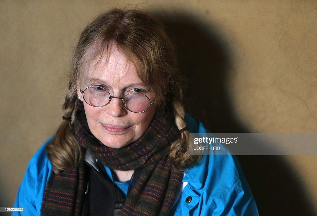 US Actress Mia Farrow, a UNICEF goodwill ambassador, visits Syrian refugees in Baalbek, in the Lebanese Bekaa valley on January 15, 2013. Farrow is on a two day visit to Lebanon, meeting Syrian refugees. AFP PHOTO/JOSEPH EID