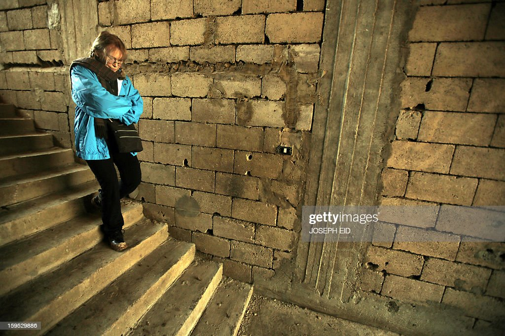 US Actress Mia Farrow, a UNICEF goodwill ambassador, walks down stairs in an unfinished building as she visits Syrian refugees in Baalbek, in the Lebanese Bekaa valley on January 15, 2013. Farrow is on a two day visit to Lebanon, meeting Syrian refugees. AFP PHOTO/JOSEPH EID