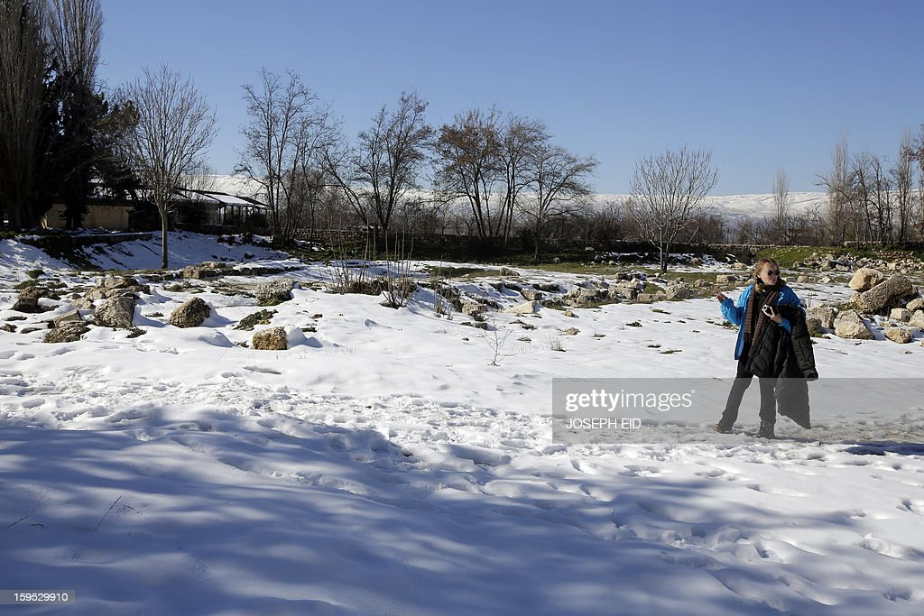 US Actress Mia Farrow, a UNICEF goodwill ambassador, walks in the snow as she visits Syrian refugees in Baalbek, in the Lebanese Bekaa valley on January 15, 2013. Farrow is on a two day visit to Lebanon, meeting Syrian refugees.