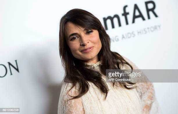 Actress Mia Maestro attends the amfAR Gala Los Angeles honoring Julia Roberts on October 13 2017 in Beverly Hills California / AFP PHOTO / VALERIE...