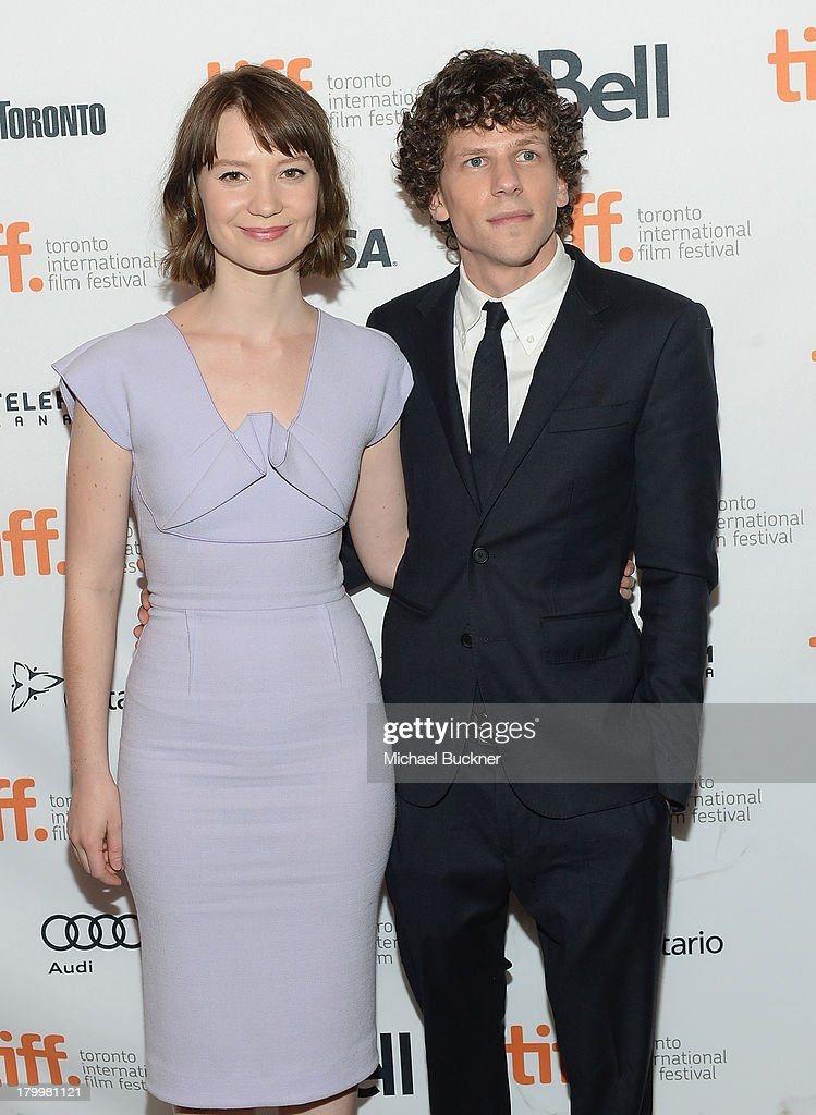 Actress <a gi-track='captionPersonalityLinkClicked' href=/galleries/search?phrase=Mia+Wasikowska&family=editorial&specificpeople=3965263 ng-click='$event.stopPropagation()'>Mia Wasikowska</a> (L) and actor <a gi-track='captionPersonalityLinkClicked' href=/galleries/search?phrase=Jesse+Eisenberg&family=editorial&specificpeople=625439 ng-click='$event.stopPropagation()'>Jesse Eisenberg</a> arrive to the premiere of 'The Double' during the 2013 Toronto International Film Festival at Winter Garden Theatre on September 7, 2013 in Toronto, Canada.