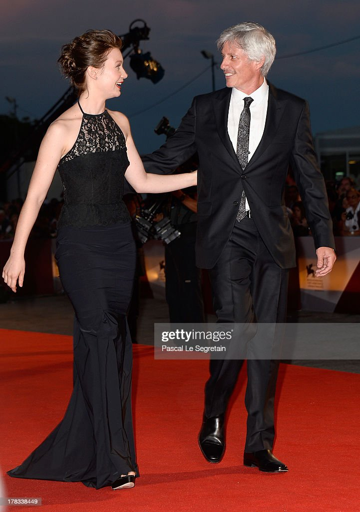 Actress <a gi-track='captionPersonalityLinkClicked' href=/galleries/search?phrase=Mia+Wasikowska&family=editorial&specificpeople=3965263 ng-click='$event.stopPropagation()'>Mia Wasikowska</a> and director John Curran attend the 'Tracks' premiere during the 70th Venice International Film Festival at the Palazzo del Cinema on August 29, 2013 in Venice, Italy.