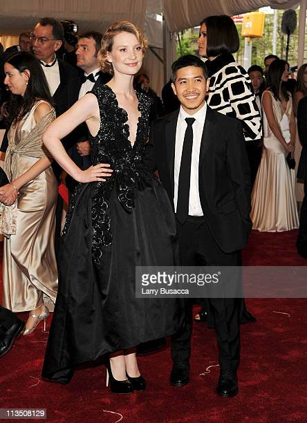 Actress Mia Wasikowska and Thakoon Panichgul attend the 'Alexander McQueen Savage Beauty' Costume Institute Gala at The Metropolitan Museum of Art on...