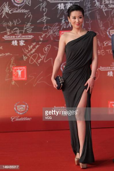 Actress Miao Pu arrives at the red carpet during the opening ceremony for the 15th Shanghai International Film Festival at Shanghai Grand Theatre on...