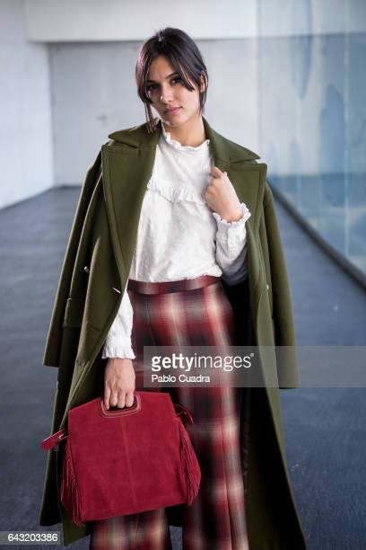Actress Michelle Calvo wears Ursula Mascaro shoes Angel Schlesser trousers shirt and jacket and Maje handbag at Ifema during Mercedes Benz Fashion...