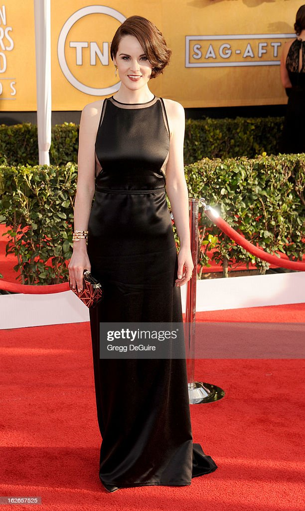 Actress <a gi-track='captionPersonalityLinkClicked' href=/galleries/search?phrase=Michelle+Dockery&family=editorial&specificpeople=4047702 ng-click='$event.stopPropagation()'>Michelle Dockery</a> arrives at the 19th Annual Screen Actors Guild Awards at The Shrine Auditorium on January 27, 2013 in Los Angeles, California.