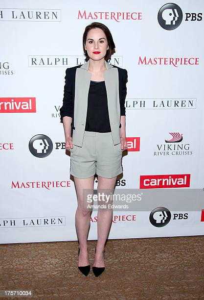 Actress Michelle Dockery arrives at the 'Downton Abbey' photo call at The Beverly Hilton Hotel on August 6 2013 in Beverly Hills California