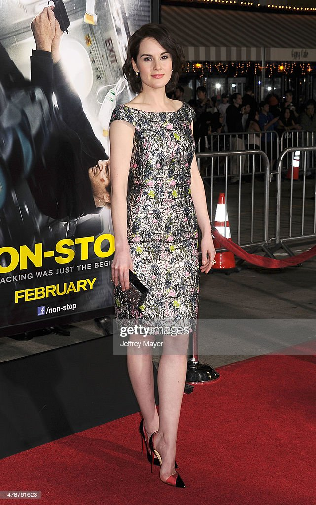 Actress <a gi-track='captionPersonalityLinkClicked' href=/galleries/search?phrase=Michelle+Dockery&family=editorial&specificpeople=4047702 ng-click='$event.stopPropagation()'>Michelle Dockery</a> arrives at the 'Non-Stop' at Regency Village Theatre on February 24, 2014 in Westwood, California.