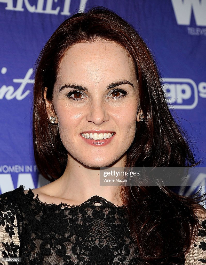Actress Michelle Dockery arrives at the Variety And Women In Film Pre-Emmy Event at Scarpetta on September 21, 2012 in Beverly Hills, California.