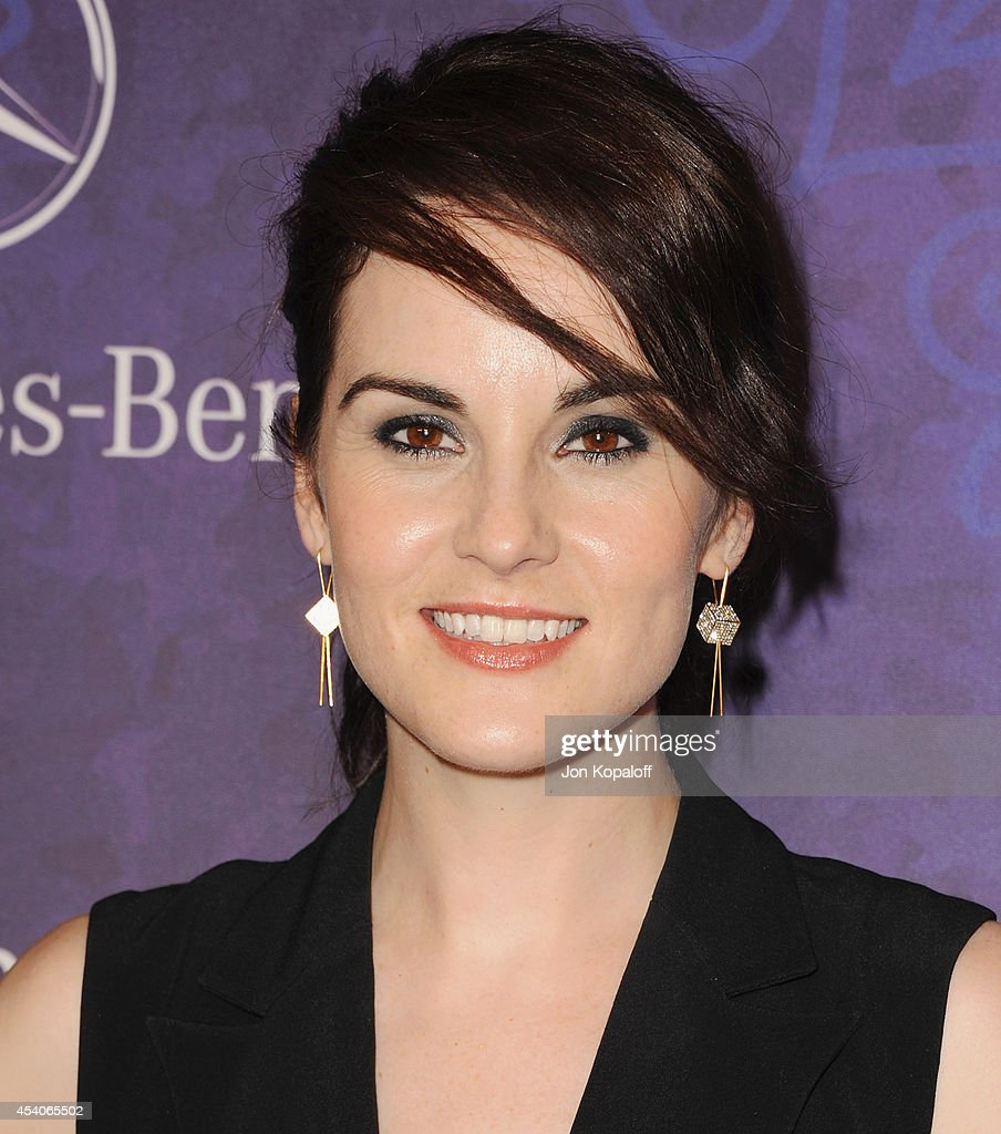 Actress Michelle Dockery arrives at Variety And Women In Film Annual Pre-Emmy Celebration at Gracias Madre on August 23, 2014 in West Hollywood, California.