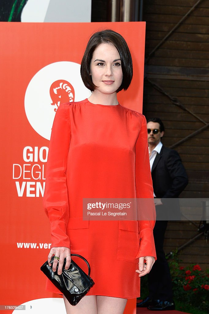 Actress <a gi-track='captionPersonalityLinkClicked' href=/galleries/search?phrase=Michelle+Dockery&family=editorial&specificpeople=4047702 ng-click='$event.stopPropagation()'>Michelle Dockery</a> attends the Miu Miu Women's Tales during the 70th Venice International Film Festival on August 29, 2013 in Venice, Italy.