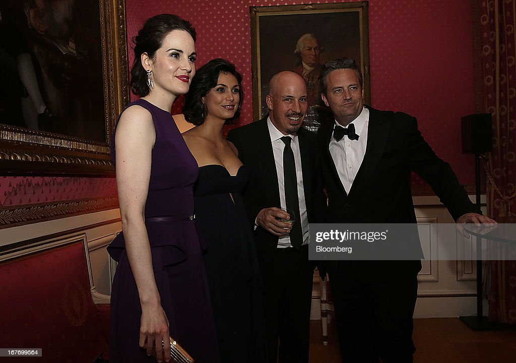 Actress Michelle Dockery, from left, actress Morena Baccarin, a guest, and actor Matthew Perry attend the Bloomberg Vanity Fair White House Correspondents' Association (WHCA) dinner afterparty in Washington, D.C., U.S., on Saturday, April 27, 2013. The 99th annual dinner raises money for WHCA scholarships and honors the recipients of the organization's journalism awards. Photographer: Scott Eells/Bloomberg via Getty Images