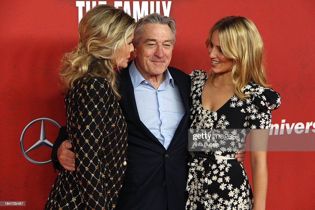 Actress Michelle Pfeiffer actor Robert de Niro and actress Dianna Agron attend the 'Malavita The Family' Germany premiere at Kino in der...