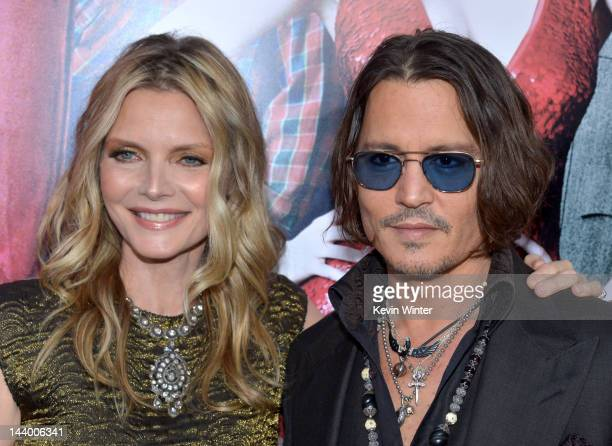 Actress Michelle Pfeiffer and actor Johnny Depp arrive at the premiere of Warner Bros Pictures' 'Dark Shadows' at Grauman's Chinese Theatre on May 7...