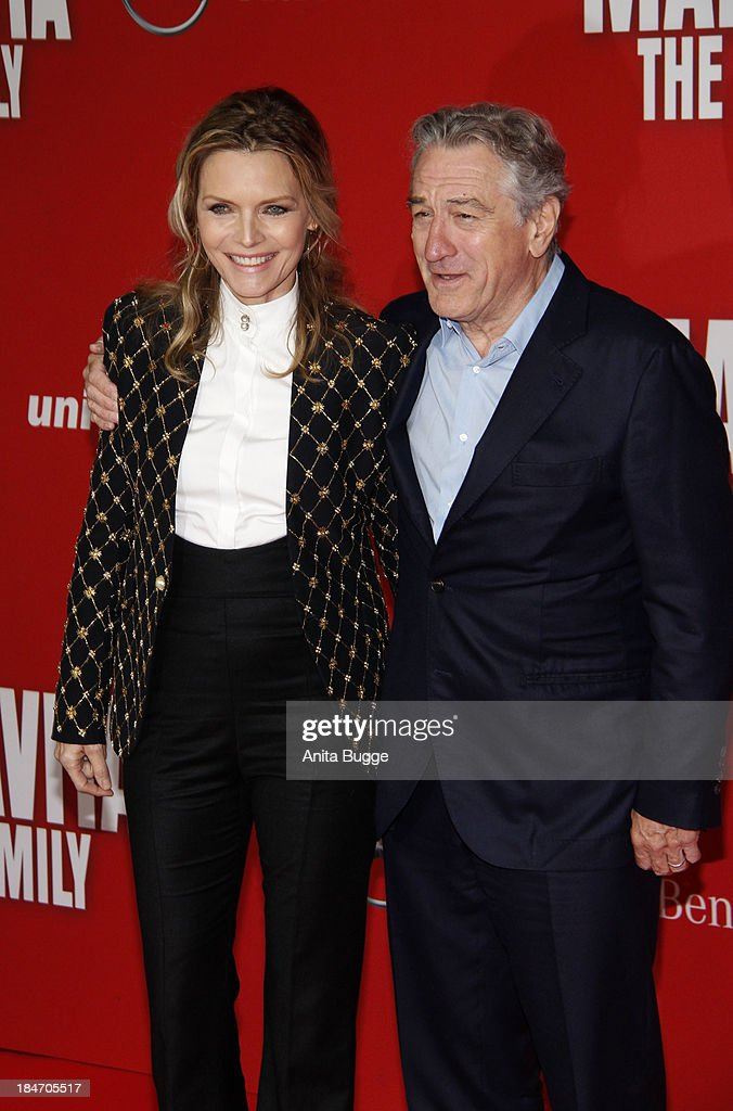 Actress <a gi-track='captionPersonalityLinkClicked' href=/galleries/search?phrase=Michelle+Pfeiffer&family=editorial&specificpeople=212951 ng-click='$event.stopPropagation()'>Michelle Pfeiffer</a> and actor Robert de Niro attend the 'Malavita - The Family' Germany premiere at Kino in der Kulturbrauerei on October 15, 2013 in Berlin, Germany.