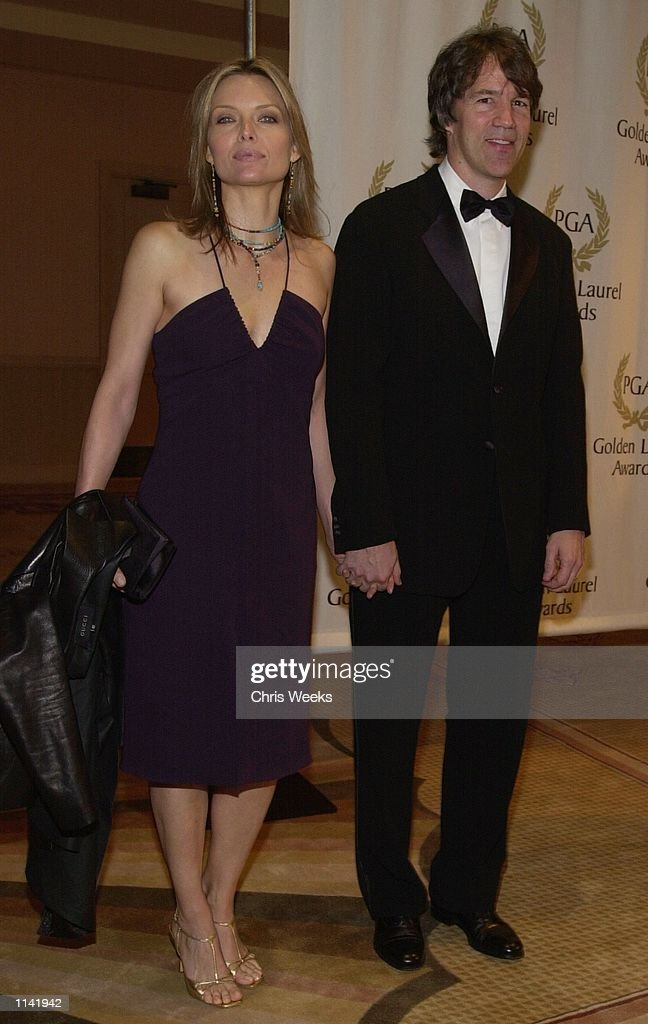 Actress Michelle Pfeiffer and husband/producer David E Kelley recipient of the 'David Susskind Lifetime Achievement Award in Television' arrive at...