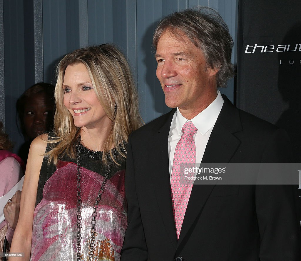 Actress <a gi-track='captionPersonalityLinkClicked' href=/galleries/search?phrase=Michelle+Pfeiffer&family=editorial&specificpeople=212951 ng-click='$event.stopPropagation()'>Michelle Pfeiffer</a> (L) and writer/ producer <a gi-track='captionPersonalityLinkClicked' href=/galleries/search?phrase=David+E.+Kelley+-+Producer&family=editorial&specificpeople=233677 ng-click='$event.stopPropagation()'>David E. Kelley</a> attend Elyse Walker Presents The Eighth Annual Pink Party Hosted By <a gi-track='captionPersonalityLinkClicked' href=/galleries/search?phrase=Michelle+Pfeiffer&family=editorial&specificpeople=212951 ng-click='$event.stopPropagation()'>Michelle Pfeiffer</a> To Benefit Cedars-Sinai Women's Cancer Program at Barkar Hangar Santa Monica Airport on October 27, 2012 in Santa Monica, California.