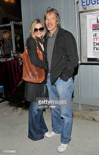 Actress Michelle Pfeiffer and writer/producer David E Kelley attend the opening night of 'It Must Be Him' at the Edgemar Center For The Arts on July...