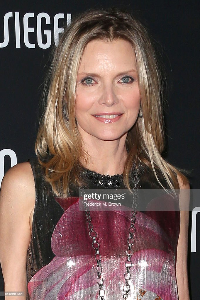 Actress <a gi-track='captionPersonalityLinkClicked' href=/galleries/search?phrase=Michelle+Pfeiffer&family=editorial&specificpeople=212951 ng-click='$event.stopPropagation()'>Michelle Pfeiffer</a> attends Elyse Walker Presents The Eighth Annual Pink Party Hosted By <a gi-track='captionPersonalityLinkClicked' href=/galleries/search?phrase=Michelle+Pfeiffer&family=editorial&specificpeople=212951 ng-click='$event.stopPropagation()'>Michelle Pfeiffer</a> To Benefit Cedars-Sinai Women's Cancer Program at Barkar Hangar Santa Monica Airport on October 27, 2012 in Santa Monica, California.