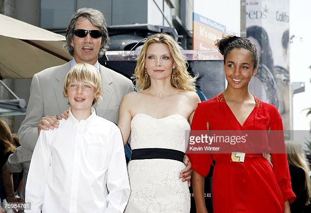 Actress Michelle Pfeiffer her husband producer David E Kelley her son John and daughter Claudia attend a ceremony honoring Pfeiffer with a Star on...