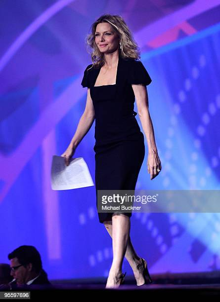 Actress Michelle Pfeiffer presents the Desert Palm Achievement award onstage at the 2010 Palm Springs International Film Festival gala held at the...